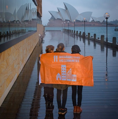 A flag to represent Goal 11, Sustainable Cities and Communities, is raised in Sydney, Australia, to support the UN Global Goals for Sustainable Development. Credit: Shane Thaw